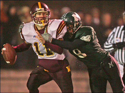 Weymouth quarterback Mike Magnell (11) is sacked by Marshfield's Jonathan Mullen.