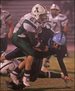 Medfield's Matt Shabanoff tackles Abington's John Creamer.