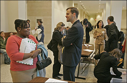 John Hill, a third-year student at Harvard Law School, talked with Amanda Welch of Roxbury at the Boston Bar Association's ''lawyer-for-the-day'' program at Boston Housing Court.
