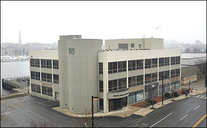 Governor Mitt Romney is laying plans to run his presidential campaign from a building at 585 Commercial St., sources say.