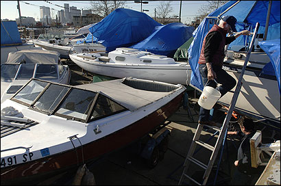 Bill Howell Sr., 76, of Wakefield, a member of the Jeffries Yacht Club in East Boston for three decades, climbed a ladder to work on his sailboat.