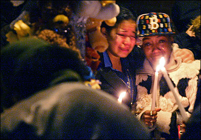Mourners gathered last night at a makeshift shrine on Holworthy Street at the site of Jahmol A. Norfleet's slaying on Tuesday. The 20-year-old, a former gang leader, was shot in the head outside his grandmother's home while talking to a friend.
