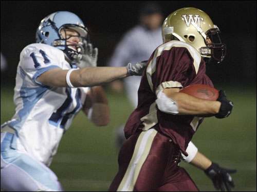 Medfield's Jamie Wulforst (11) tried to tackle Whittier's Jay Pena (7) during game action.