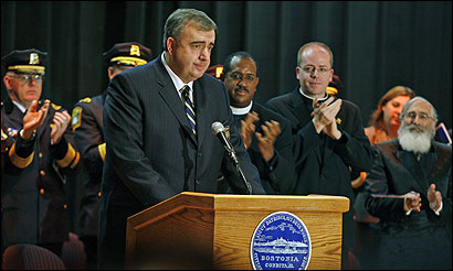 Edward F. Davis III took the oath as Boston's police commissioner yesterday with a vow that his department will grow more diverse, gain credibility in the community, and look for more creative ways to confront violent crime. Standing at rear (from left) were the Rev. Gregory G. Groover Sr., the Rev. Sean Connor, and Rabbi Ira Korff, all Police Department chaplains.