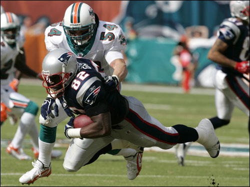 Patriots tight end Daniel Graham (82) was stopped by Dolphins linebacker Zach Thomas (54) in the first quarter.