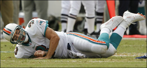 Dolphins quarterback Joey Harrington screamed as he lay on the turf after injuring his foot in the second quarter.