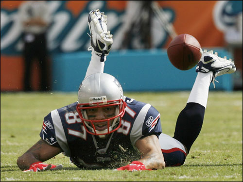 Patriots wide receiver Reche Caldwell slid on the turf after an incomplete pass.