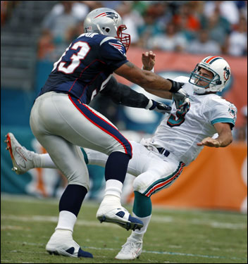 Patriots defensive lineman Richard Seymour (left) put a late hit on Joey Harrington (right) and was flagged for roughing the passer.