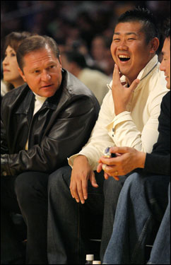 Matsuzaka, right, listens to his agent, Scott Boras, as they watch the Los Angeles Lakers battle the Chicago Bulls on Nov. 19, in Los Angeles.