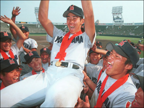 Matsuzaka is hoisted by his teammates after the closing ceremonies of the 80th National High School Championships. In the quarterfinals of the same tournament, Matsuzaka hurled 250 pitches over 17 innings in a win over powerhouse P.L. Gakuen.