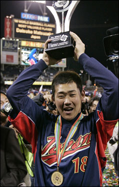 Matsuzaka holds up the MVP trophy following Japan's 10-6 victory over Cuba in the World Baseball Classic championship game on March 20.