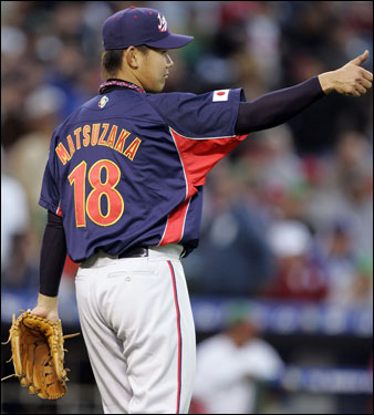 Matsuzaka acknowledges his teammates during a game against Mexico during the World Baseball Classic in Anaheim, Calif., on March 14, 2006.