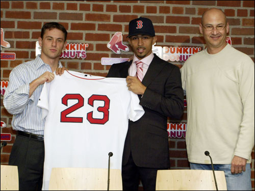 Around 3:30 p.m., while Matsuzaka and Co. made their way to Boston, the Red Sox officially announced the signing of shortstop Julio Lugo to a four-year, $36-million pact. Lugo holds up his No. 23 jersey flanked by Red Sox assistant general manager Jed Hoyer, left, and manager Terry Francona.