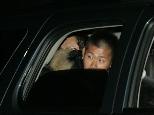 Matsuzaka peers out the window as his vehicle pulls out of Hanscom Air Force Base.
