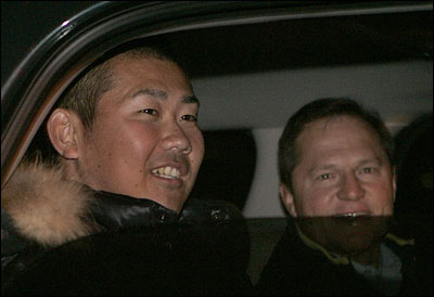 Daisuke Matsuzaka and his agent, Scott Boras, smile as he departs Hanscom Air Force Base en route to Mass. General Hospital.