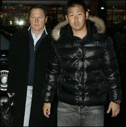 Daisuke Matsuzaka (right) arrived at Mass. general last night for his physical. (AP Photo)   Photo gallery