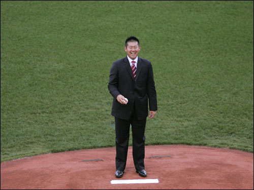 Matsuzaka smiles while standing on the pitcher's mound at Fenway Park.