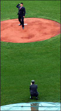 Matsuzaka throws a pitch to Red Sox owner John W. Henry.