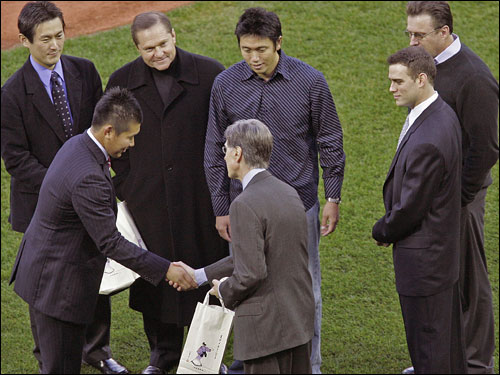 Matsuzaka gave gifts, shook hands, and bowed to owner John W. Henry on the field.