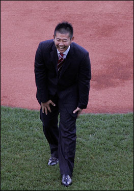 Matsuzaka reacts after Henry falls.