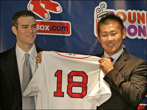 Matsuzaka holds up his new No. 18 jersey (he was No. 18 with the Seibu Lions) alongside Theo Epstein.