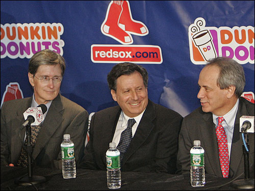 Red Sox management -- John W. Henry, Tom Werner and Larry Lucchino -- smile during the Matsuzaka press conference.