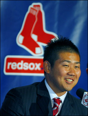 Daisuke Matsuzaka had a big smile as took questions at the press conference.