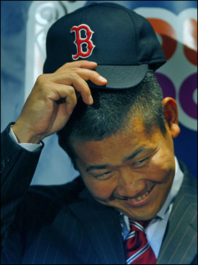Matsuzaka had a big smile as he tried on his new Red Sox hat.