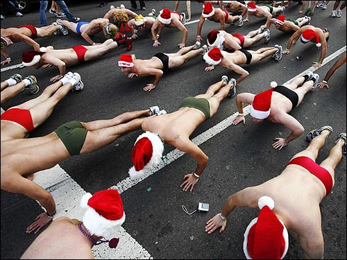 Participants of the Santa Speedo Run warmed up by doing push ups before the beginning of their annual traditional run from Lir Irish Pub on Boylston Street, down to Commonwealth Avenue before returning via Newbury Street.