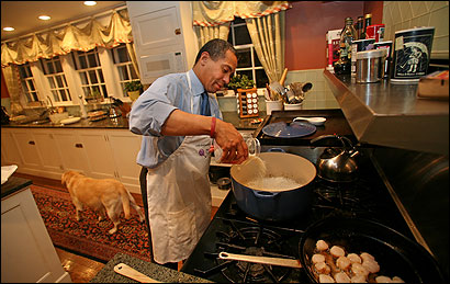 Deval Patrick added risotto to a Dutch oven Thursday night while the scallops cooked. He was serving up dinner for a dozen guests.