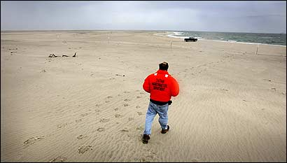 Chatham Harbormaster Stuart Smith walked Wednesday from South Monomoy Island to his truck, parked on a new sand formation that now connects South Monomoy Island to South Beach in Chatham.