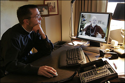 The Rev. Robert Reed listened to Cardinal Sean O'Malley's holiday message via video on the Catholic Television website. In the new year, O'Malley will also begin Internet podcasts.