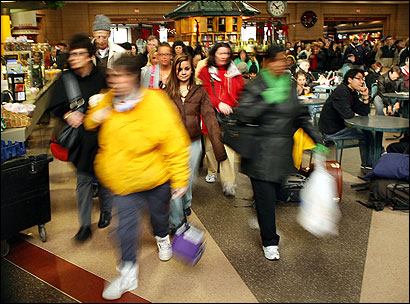 HOLIDAY EXODUS — Passengers catching the 2 p.m. Amtrak train to Washington, D.C., Friday dashed to the doors. They were among the thousands of riders who crowded the trains at South Station.