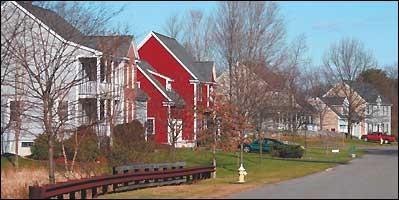Houses in the Assabet Estates cluster development in Westborough are closer than in conventional subdivisions, but more open space is being left behind as conservation land.
