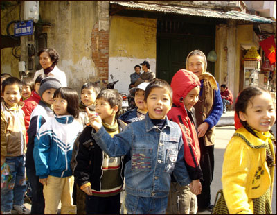 A group of children in the Old Quarter of Hanoi, a densely packed district popular with tourists.