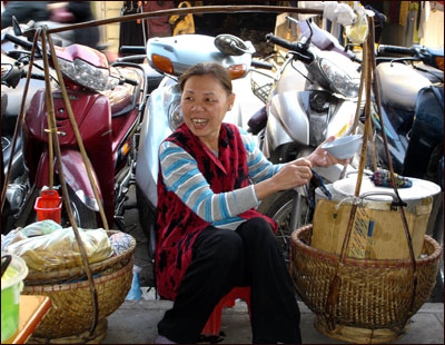 A woman sells lunch on the streets of Hanoi.
