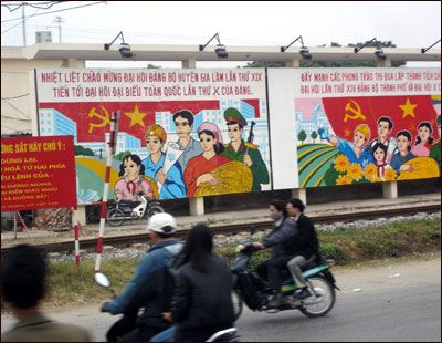 Communist propaganda still lines the streets leading into Hanoi.