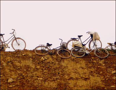 A group of bikes lay on an embankment in Vietnam.