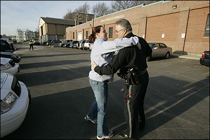 Sergeant Karen Ahern gave officer Fred Coriano a hug yesterday on their last day with the Municipal Police Department. She had been on the force 10 years.