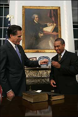 Gov. Mitt Romney prepared to leave the State House in the symbolic end of his governorship. He gave Gov.-elect Deval Patrick the symbols of the office including a key, a Bible, and a gavel.