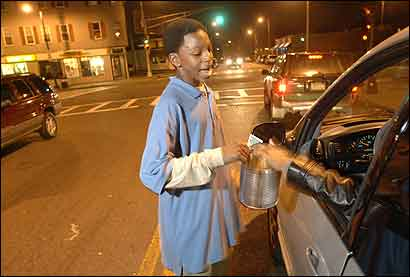 Dorchester's Stanley Harris, 13, raised funds for his Pop Warner team's trip to Florida.