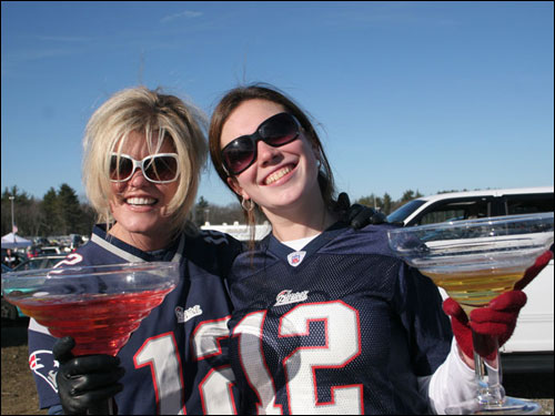 Jennifer Saccone (left) and Nicole Fallon patrolled a parking lot outside Gillette Stadium in Foxborough with enormous martini-shaped glasses.