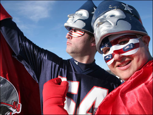 Patriots fans Wayne 'Fan Man' Bouthillette (left) and Brian 'Captain Patriot' Molis incited tailgaters outside Gillette Stadium before the Patriots-Jets game Sunday.