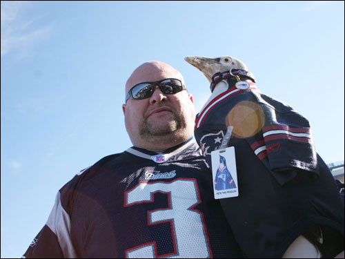 Donny 'the Penguin Guy' Reisner displayed his good-luck statue 'Pete the Penguin' outside Gillette Stadium. With Pete on hand, the Patriots have won 32 games, Reisner says.