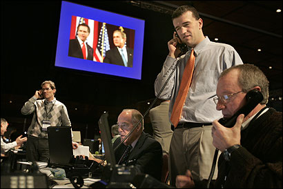 Cole Clinger (standing), Will Milham (bottom-right), and others worked the phones to raise money for Mitt Romney's presidential campaign.