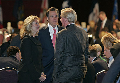 William F. Weld (right) spoke to fellow former governor Mitt Romney and his wife, Ann, at the fund-raiser.