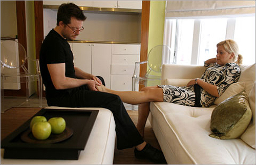 Customers relax on a white leather banquette for the quickie massage.