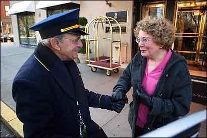 60-year doorman Norman Pashoian with Ritz regular Margaret Smith. His uniform will change tomorrow.