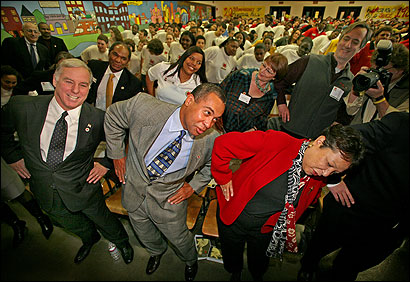 Governor Deval Patrick, his wife, Diane, and Howard Dean, chairman of the Democratic National Committee, joined in a physical training demonstration led by City Year Boston Young Heroes during a Martin Luther King Day celebration at the James P. Timilty School in Roxbury.