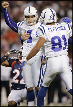Vinatieri celebrates his 37-yard field goal with two seconds remaining that lifted the Colts over the Denver Broncos in Week 8.